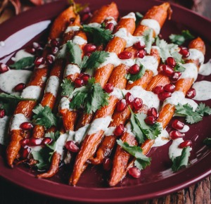 Colorful and dramatic Recipe! Roasted whole Carrots, Green Tahini Sauce, Pomegranate Seeds!